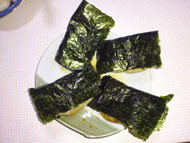 Isobeyaki: With soy sauce and wrapped with seaweed